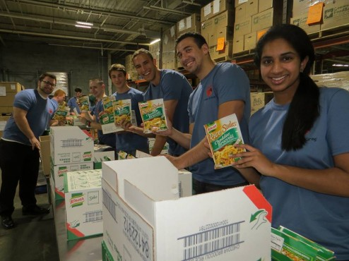 Sophia Joseph, far left, helping at The Community Food Bank of New Jersey with other Wakefern employees