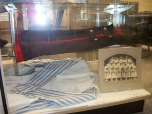 Display case with nursing uniform and historic photograph