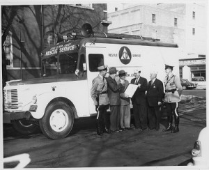 Leonard Dreyfuss and group next to Civil Defense Rescue Service truck, from the Leonard Dreyfuss papers, Mss 0001