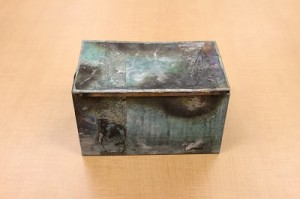 Tin box which was inserted in the cornerstone of the Chancery building in 1932