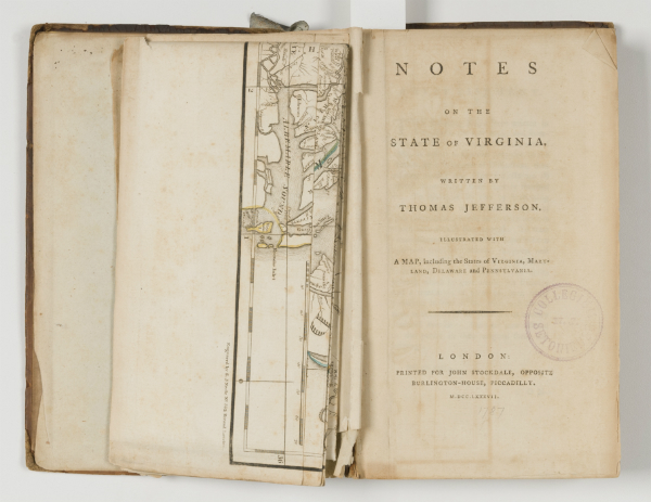 Notes on the State of Virginia before treatment, showing the fold out map settled at a slight angle and damage to the leaves, especially near the bottom of the spine.