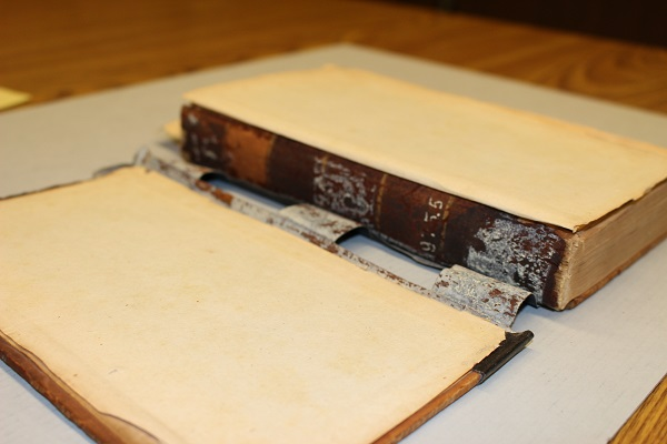 Damage caused by the use of adhesive tape to reattach the book's covers.