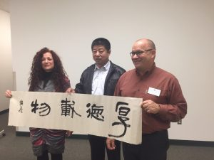 Jeanne Brasile, Peiliang Zheng, and Greg Stevens with the finished calligraphy