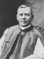 Black and white photograph of Msgr. John A. Stafford, seated