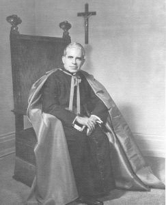 Black and white image of Bishop John Joseph Dougherty seated, c. 1960s
