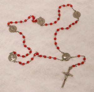 Rosary with made of red plastic beads and a metal chain and crucifix, Collection on Pope John Paul II (MSS 0004)