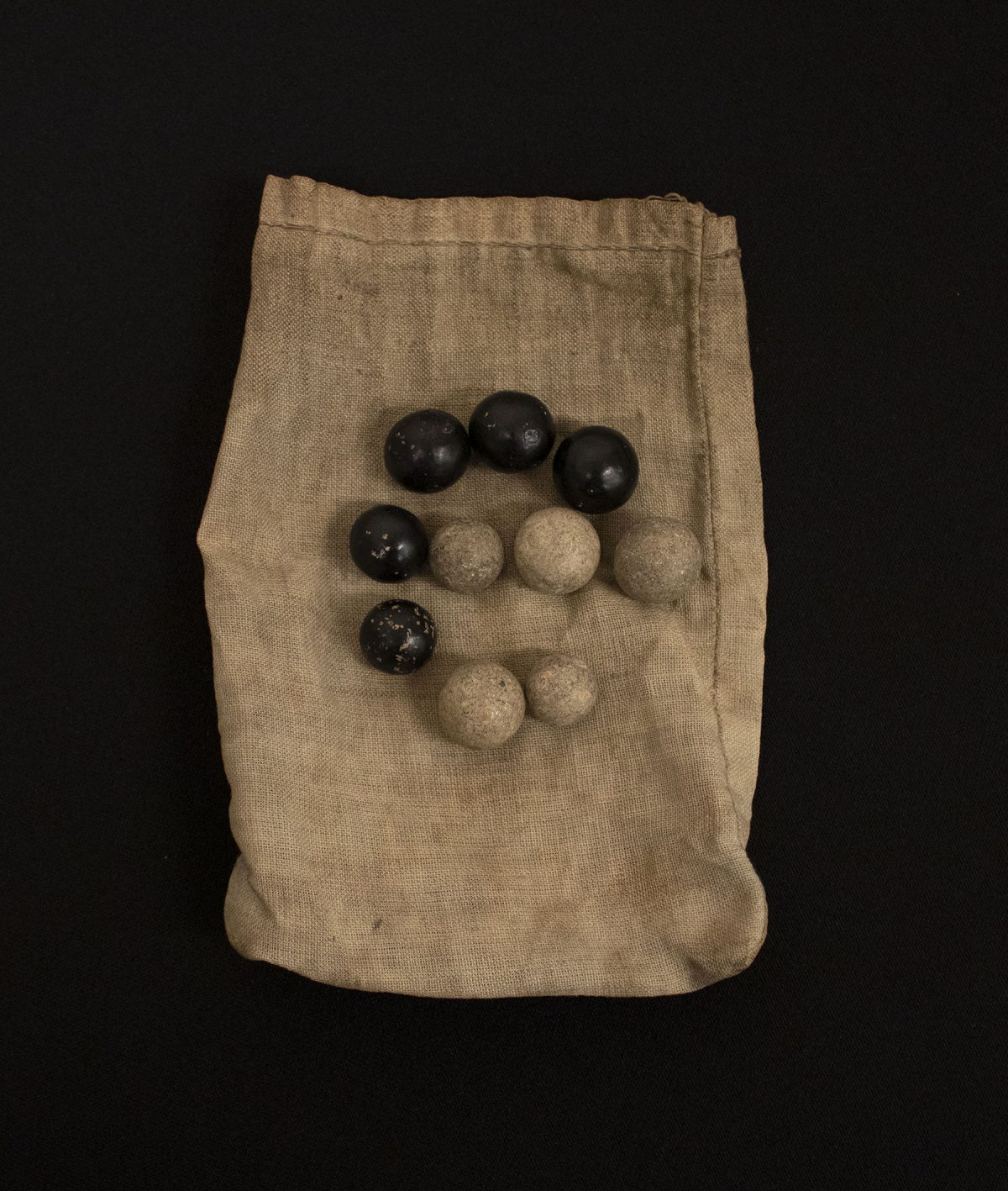 Ballot Balls and Bag from the Sons of Italy, Umberto Primo Lodge No. 750 (Susquehanna, PA) wood, paint and fiber undated 2019.12.0004 Gift of the New Jersey Grand Lodge, Order of the Sons of Italy