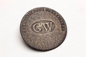 "Brass button that says, ""G.W. - Long Live the President"""