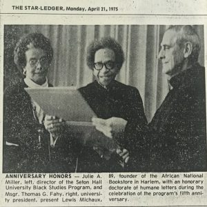 Newspaper Clipping of Msgr Fahy with Black Studies faculty