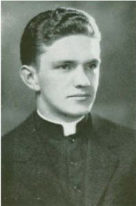 Black and white image of Monsignor James Kelley