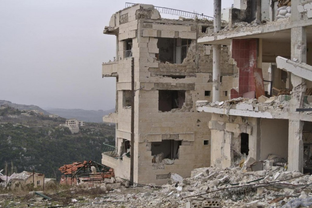 Destroyed buildings are seen in Salma, Syria, Friday, Jan. 22, 2016. Syrian government forces relying on Russian air cover have recently seized Salma, located in Syria's province of Lattakia, from militants. The Syrian government offensive has given Assad a stronger hand going into peace talks with the opposition that are planned for next week in Switzerland. (AP Photo/Vladimir Isachenkov)