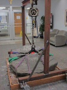 After some clean up, the petroglyph is strapped, lifted, and ready to be wheeled across campus.