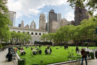 This is Bryant Park as we know it today. Captured behind the green lot is the New York Public Library.