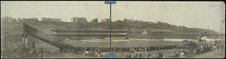 A view from the early days of the Polo Grounds during the 1905 World Series. Notice how fans are standing in the outfield and that there is no fence in the outfield. Also take note of the horses and carriages in the very front of the picture.[10]