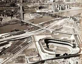 Yankee Stadium and the Polo Grounds looking each other down across the Harlem River. The Macombs Dam Bridge located on the left, is one of the oldest bridges in New York City. It still stands today and can be seen when traveling across the river to Yankee Stadium.[31]