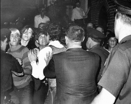 Police officers raided the Stonewall Inn which sparked a series of violent protests. Riots soon erupted as crowds attempted to impede police arrests outside Stonewall Inn. This is one of the very first photos that captured the riot.