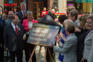 U.S. Assembly member Jerrold Nadler, Mayor Bill de Blasio, Secretary of the Interior Sally Jewel, Valerie Jarrett and NY State Assemblymember Debra Glick unveil the sign designating Stonewall Inn a national monument.