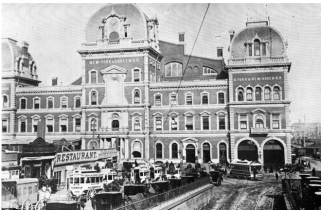 This is an image of the Grand Central Depot. On the building itself, you can see two of the three railroad lines that fell under the NY Central and Hudson Railroad company: NY and Harlem Railroad and New York and New Haven Railroad. On the lower left of the image, you can see people and rail tracks crossed in the same area which were one of the major concerns that led to the downfall of the Grand Central Depot.