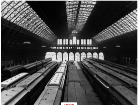 This is an image of the interior of the Grand Central Depot. It was the largest interior space in the entire nation. As shown in the picture, the building's roof is made out of iron and glass. There are multiple trains within the three railroad lines under the NY Central and Hudson railroad company to show that a large amount of trains went in and out of the Grand Central Depot.