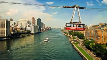 Picture is the Roosevelt Island Air Tram, that connect the city to the island. Since its opening in 1976, it has been a staple attraction to the city.