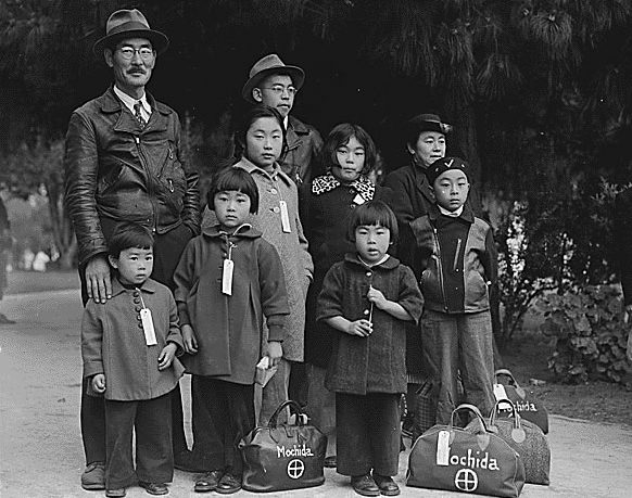 Members of the Mochida family awaiting their evacuation bus in Hayward, Calif. From Flickr.