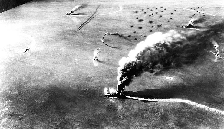USS Yorktown and USS Enterprise dive bombers attacking Japanese aircraft carriers during the Battle of Midway. From Wikimedia Commons.
