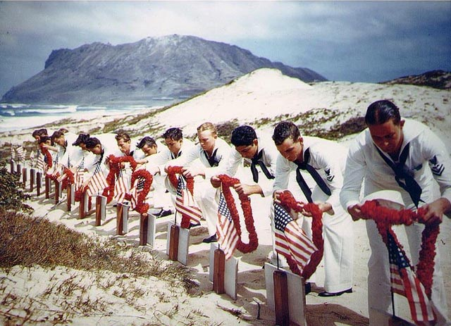 Sailors honoring the men killed during Pearl Harbor on Naval Air Station Kaneohe, Oahu. After several heart-breaking defeats, Americans try to cling on to hope. From Wikimedia Commons.