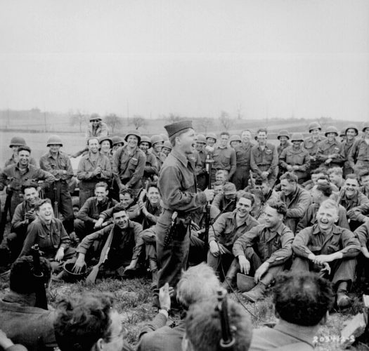 Actor Mickey Rooney entertaining the infantrymen of the 44th Division with imitations of other Hollywood actors. From Wikimedia Commons.