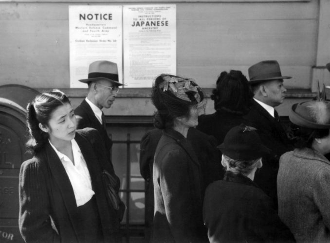 Japanese Americans waiting for processing for internment. From Wikimedia Commons.