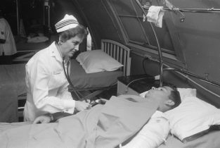 A U.S Navy Nurse using her skill set to aid in the war effort. From Wikimedia Commons.