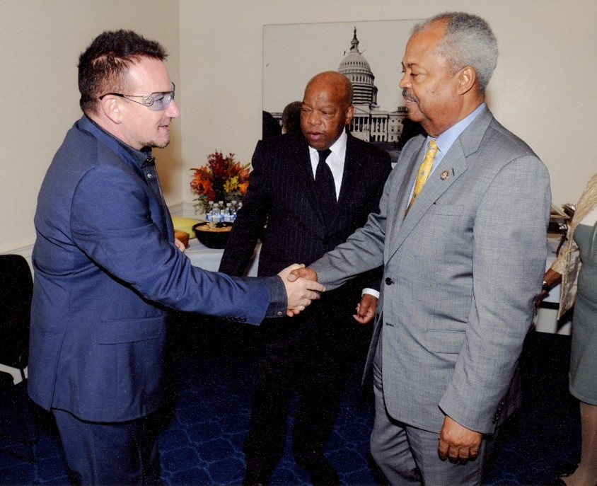 Donald Payne (R) greets singer and human rights activist, Bono (L) - Congressman John Lewis (center) – MSS0078 courtesy of Archives and Special Collections
