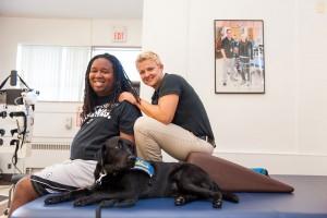 A GOOD TEAM: Wojciehowski, LeGrand and therapy dog Willie.